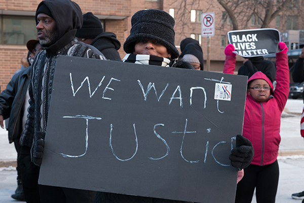 Protestors marched to the Racine County Courthouse Monday to protest the death of Donte Shannon, who was killed by police officers on Jan. 17. Officials with the Wisconsin Department of Justice say that Shannon brandished a gun. His friends and family want more details. PHOTO CREDIT: René Amado